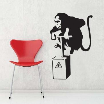 banksy muurstickers aap & bom